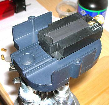 Adjustable charge bar